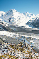 Tasman Glacier as seen from Ball Ridge in morning with De la Beche 2950m in background and climber giving sense of scale at end of ridge, Mt. Cook National Park, World Heritage, Mackenzie Country, South Island, New Zealand