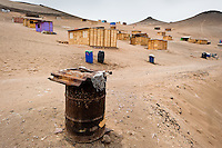 A rusty barrel, used for water storage, is seen on the dusty hillside of Pachacútec, a desert suburb of Lima, Peru, 22 January 2015. Although Latin America (as a whole) is blessed with an abundance of fresh water, having 20% of global water resources in the the Amazon Basin and the highest annual rainfall of any region in the world, an estimated 50-70 million Latin Americans (one-tenth of the continent's population) lack access to safe water and 100 million people have no access to any safe sanitation. Complicated geographical conditions (mainly on the Pacific coast), unregulated industrialization (causing environmental pollution) and massive urban poverty, combined with deep social inequality, have caused a severe water supply shortage in many Latin American regions.