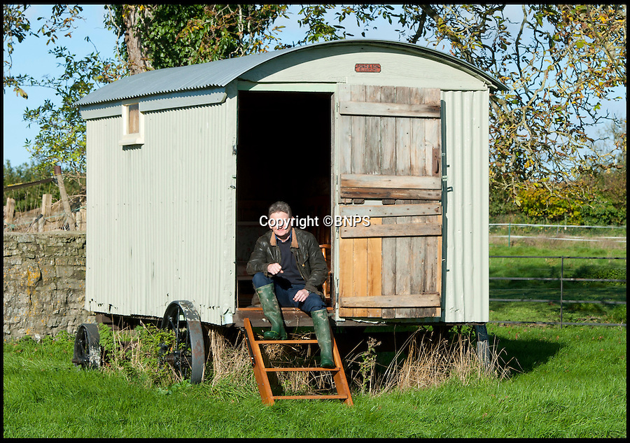BNPS.co.uk (01202 558833)<br /> Pic: LauraJones/BNPS<br /> <br /> David Morris with the conserved shepherd's hut.<br /> <br /> The shepherd's hut used by the real-life Gabriel Oak, the main love interest in the new movie Far From the Madding Crowd, has been saved from ruin after being found abandoned in a hedgerow.<br /> <br /> The cabin on wheels belonged to Waterston Manor, the inspiration for fictional Weatherbury Farm which Carey Mulligan's character Bathsheba Everdene owns in the film adaptation of the Thomas Hardy classic novel.<br /> <br /> It has been returned to its former glory by historian David Morris.