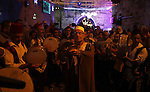 Muslim Sufis play musical instruments as they parade through the streets during the holy month of Ramadan in Jerusalem's old city, 29 June 2015. During Ramadan, Muslim believers abstain from eating, drinking, smoking and having sex from dawn until sunset. Ramadan is sacred to Muslims because it is during that month that tradition says the Koran was revealed to the Prophet Mohammed. The fast is one of the five main religious obligations under Islam. Photo by Saeb Awad