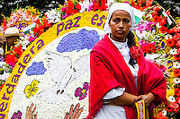 A woman waits to participate on the 58th Silleteros' parade in the framework of the flowers fair, this year the silleteros' parade was declared intangible heritage of Colombia. Medellín, Colombia 09/08/2015