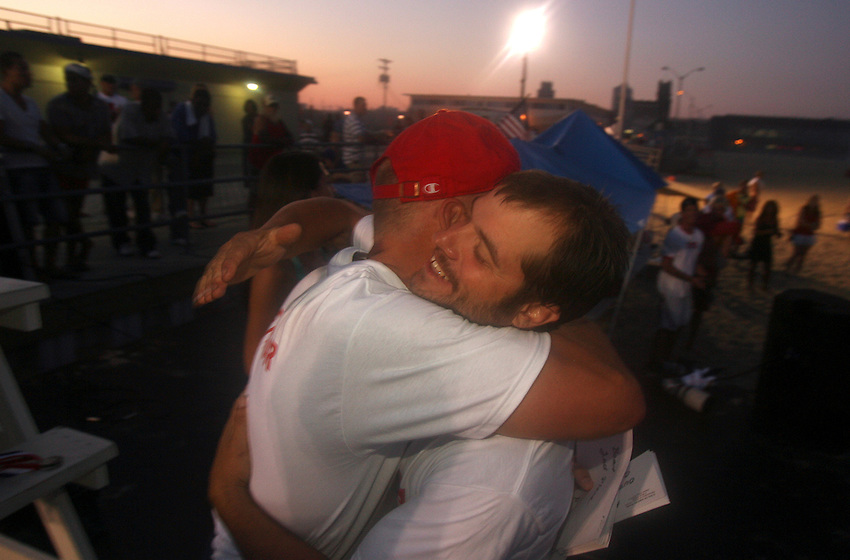 """Tournament organizer Dave Healy (left) embraces fellow Asbury Park competitor Paul """"Bug"""" Elyssev  during the awards ceremony after the First Annual Asbury Park Beach Bar Lifeguard Competition held at the 3rd Avenue beach in Asbury Park. ASBURY PARK, NJ  8/4/07  8:21:47 PM  PHOTO BY ANDREW MILLS"""