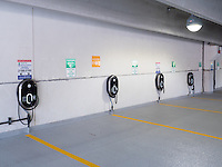 GE Wattstation electric vehicle charging stations mounted on the wall in the North White Plains Station Parking Garage.