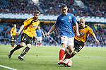 Fraser Aird takes the ball into the corner.
