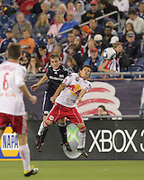 New England Revolution defender Seth Sinovic (27) and New York Red Bulls midfielder Sinisa Ubiparipovic (8) battle for head ball. The New England Revolution defeated the New York Red Bulls, 3-2, at Gillette Stadium on May 29, 2010.