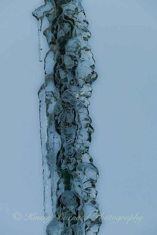 Icicles forming on a chain. The ice making sculptures of faces. Hence the name Chain Gang