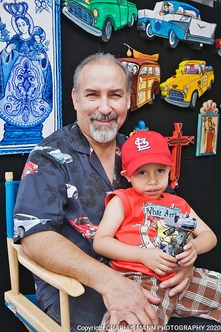 The Santa Fe Spanish Market, held in July, fills the Santa Fe Plaza with artists parton and visitors all celebrating traditional Spanish colonial arts. It is held side by side with the Contemporary Spanish Market which features modern Hispanic artists.Santero Charlie Carillo and grandson Larry Angel Garcia.