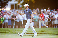 Dustin Johnson waves to the waves as he makes his way to the 18th green during the 2016 U.S. Open in Oakmont, Pennsylvania on Sunday June 19, 2016. (Photo by Jared Wickerham / DKPS)