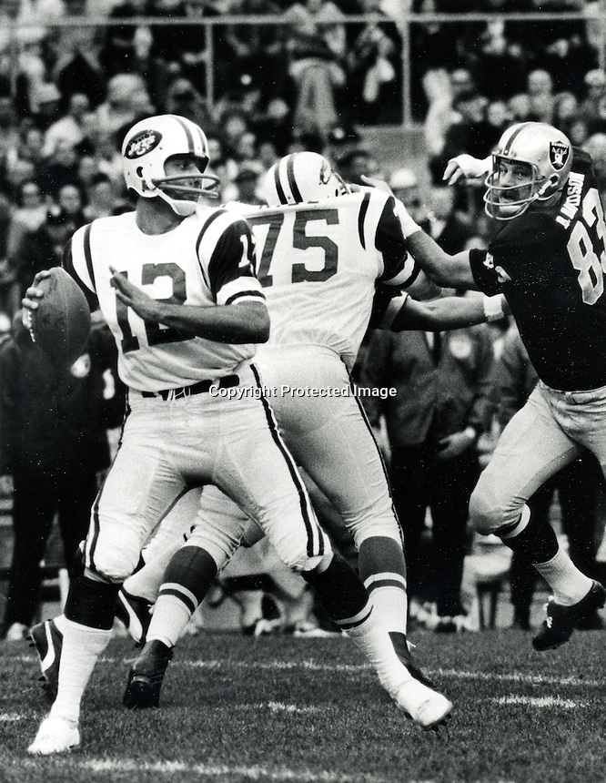 New York Jet QB Joe Namath gets a rush from Raider DE Ben Davidson.photo: copyright 1969 Ron Riesterer