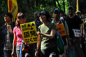 Tokyo, Japan - June 17: Two women held a sign against nuclear power plants in Japan during a demonstration at Inokashira Park, Mitaka, Tokyo, Japan on June 17, 2012. As Japanese Government decided to restart Oi Nuclear Power Plants No.3 and 4 in Fukui, people spoke up against the restart throughout the nation. .