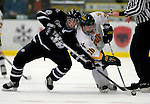 5 January 2007: University of New Hampshire forward Greg Collins (8) from Fairport, NY,battles Vermont forward Reese Wisnowski (20) from East Middlebury, VT at Gutterson Fieldhouse in Burlington, Vermont. The UNH Wildcats defeated Vermont 7-1 in front of a record setting 48th consecutive sellout at &quot;the Gut&quot;...Mandatory Photo Credit: Ed Wolfstein Photo.<br />
