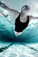 Woman swimming in a pool.