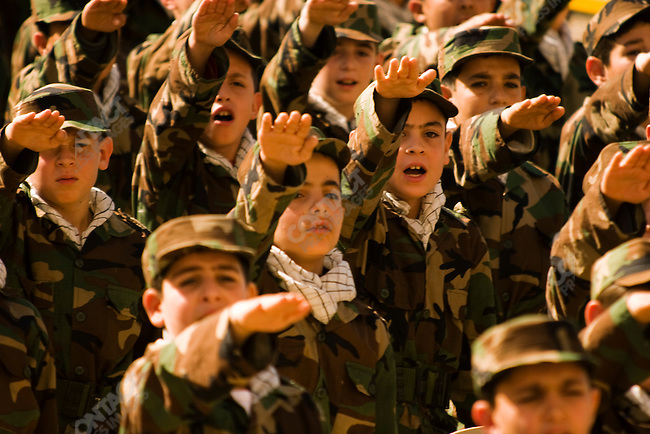 On Martyr's Day, Hezbollah's Al Mahdi Scouts vow willingness to be martyred in a ceremony attended by the Deputy Secretary Sheikh Naim Qassem. Guerillas, educators, politicians and others will be culled from these ranks of boys, who belong to highly vetted Hezbollah families. Tyre, Lebanon. November 2005