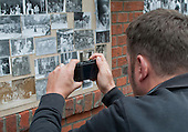 Snapping some old photos on display at the reunion for Summerhill School's 90th birthday celebrations.