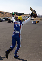 Jul. 28, 2013; Sonoma, CA, USA: NHRA pro stock motorcycle rider Hector Arana Jr runs to celebrate with pro stock winner Vincent Nobile after winning the Sonoma Nationals at Sonoma Raceway. Mandatory Credit: Mark J. Rebilas-