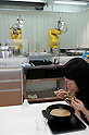 NAGOYA - SEPTEMBER 3, 2009: Aisei, an industrial robot maker in Nagoya opens Fa-men, a noodle shop where two robot arms work as hi-tech chefs that feed and entertain customers. (Photo Laurent Benchana/Nippon News)