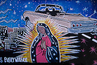 A mural painted on the side of a dumpster in Rio Arriba County near Espanola,  New Mexico, proclaims the dangers facing youth and the vigilant love offered by the Virgin of Guadalupe