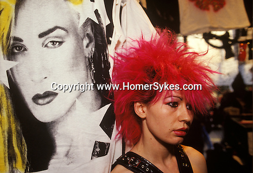 Punk girl with red hair &quot;Kings Road&quot; Chelsea shop assistant in Boy boutique, the image of the singer Marilyn is a t-shirt, displayed in sealed clear vinyl. London  England 1983.<br /> Boy was at 153 King&rsquo;s Road