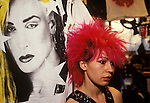 "Punk girl with red hair ""Kings Road"" Chelsea shop assistant in clothes boutique poster is of Marilyn pop singer.  London  England circa 1985"