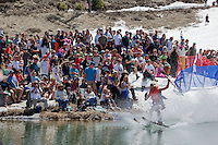 """Cushing Classic at Squaw Valley 8"" - Photograph of a skier crossing a pond during the Cushing Classic at Squaw Valley, USA."