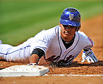 28 February 2011: New York Mets infielder Ruben Tejada dives back to first during a Spring Training game against the Washington Nationals at Digital Domain Park in Port St. Lucie, Florida. The Nationals defeated the Mets 9-3 in Grapefruit League action. Mandatory Credit: Ed Wolfstein Photo