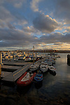 Caleta de Fuste at dusk, with fishing and pleasure boats moored in the harbour, Fuerteventura, Canary Islands, Spain