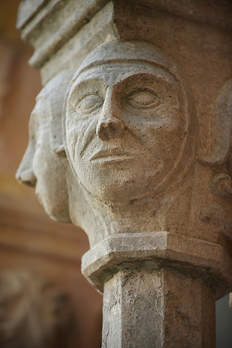 Stock photos of Sculptured face historiated Romanesque column Capitals - Franciscan Monatery cloisters - Dubrovnik