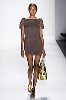 Model walks runway a DESERT SILK MOUSSELINE LINEN MINI DRESS W/DRAPED GOLD CHAINS by Zang Toi, for the Zang Toi Spring 2012 My Dream Of North Africa Collection, during Mercedes-Benz Fashion Week Spring 2012.