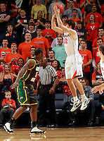 CHARLOTTESVILLE, VA- DECEMBER 6: Joe Harris #12 of the Virginia Cavaliers shoots over Vertrail Vaughns #11 of the George Mason Patriots during the game on December 6, 2011 at the John Paul Jones Arena in Charlottesville, Virginia. Virginia defeated George Mason 68-48. (Photo by Andrew Shurtleff/Getty Images) *** Local Caption *** Joe Harris;Vertrail Vaughns