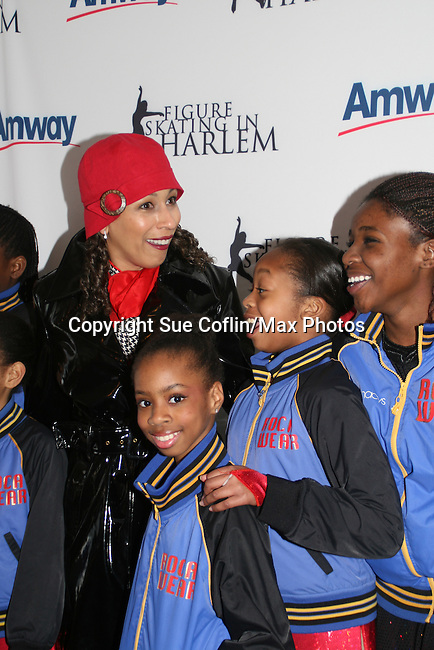 Tamara Tunie (gala co-chair) and skaters at the 2009 Skating with the Stars - a benefit gala for Figure Skating in Harlem on April 6, 2009 at Wollman Rink, Central Park, NYC, NY. (Photo by  Sue Coflin/Max Photos)