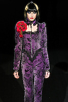 Ksenina walks runway in a Killing Me Softly outfit, from the Betsey Johnson Fall 2011 He Loves Me Not - Black Tag collection, during Mercedes-Benz Fashion Week Fall 2011.