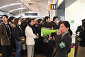March 17, 2011, Tokyo, Japan - Station staff make an announcement to commuters at Shinagawa Station in Tokyo trying to make it home before a possible power outage planned in an attempt to conserve electricity. The power grid has been impacted heavily by the recent earthquake and its aftermath. (Photo by YUTAKA/AFLO) [1040]