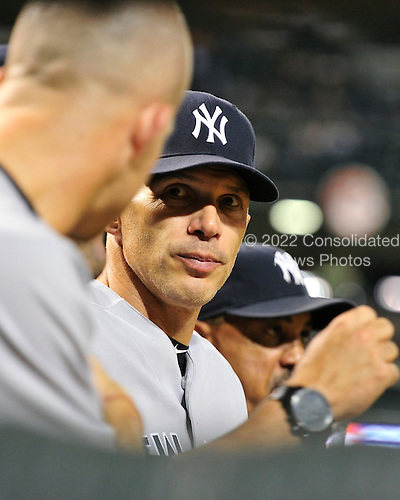 New York Yankees manager Joe Girardi (28) chats with his players in the dugout in the ninth inning against the Baltimore Orioles at Oriole Park at Camden Yards in Baltimore, Maryland in the second game of a doubleheader on Sunday, August 28, 2011.  The Yankees won the game 8 - 3, earning a split in the two games..Credit: Ron Sachs / CNP.(RESTRICTION: NO New York or New Jersey Newspapers or newspapers within a 75 mile radius of New York City)