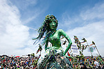 Jack-in-the-Green, Hastings, Sussex, UK (May 2014). Jack-in-the-Green is a traditional May Day festival held on May Bank Holiday in England, originating several hundred years ago, in which a man covered in a tall conical green mass of foliage (the 'Jack') is paraded through the town – typically accompanied by much revelry (and beer) – to mark the end of winter and the beginning of summer. The tradition was originally associated with chimney sweeps, but went out of fashion in the Victorian Britain of the late 19th century, being replaced by a tamer and less bawdy May Day/May Queen celebration. Several Jack-in-the-Green festivals were revived towards the end of the 20th century – Hastings Jack-in-the-Green in 1983, Rochester (the 'Sweeps Festival') in 1980, Whitstable in 1976. 'Jack' is accompanied by Bogies, painted and dressed in green, together with other characters and troops of Morris Dancers. © Rudolf Abraham. All Rights Reserved.
