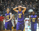 "Louisiana State's Matt Derenbecker (21) and Louisiana State's Eddie Ludwig (13) and Louisiana State's Andre Stringer (10) react towards the end of the game at the C.M. ""Tad"" Smith Coliseum in Oxford, Miss. on Wednesday, February 9, 2011. Ole Miss won 66-60 and is now 4-5 in the Southeastern Conference."