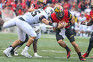 College Park, MD - October 1, 2016: Maryland Terrapins quarterback Perry Hills (11) avoids the tackle by Purdue Boilermakers defensive end Evan Panfil (95) during game between Purdue and Maryland at  Capital One Field at Maryland Stadium in College Park, MD.  (Photo by Elliott Brown/Media Images International)