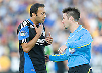 Ramiro Corrales of Earthquakes talks with the referee Edvin Jurisevic during the game against the Sounders at Buck Shaw Stadium in Santa Clara, California on July 31st, 2010.   Seattle Sounders defeated San Jose Earthquakes, 1-0.
