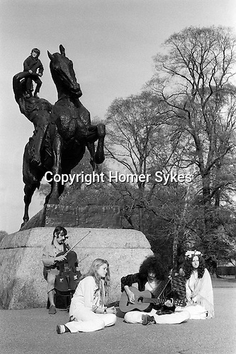 Hippies playing music in Kensington Gardens central London England 1971