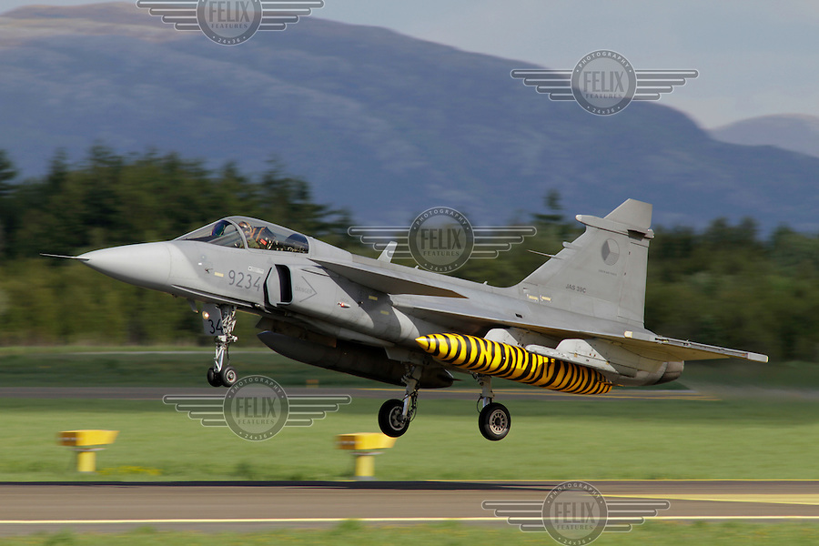 Swedish JAS Gripen  lands. Nato Tiger Meet is an annual gathering of squadrons using the tiger as their mascot. While originally mostly a social event it is now a full military exercise. Tiger Meet 2012 was held at the Norwegian air base Ørlandet.