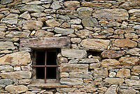 Window and wall of small church in Italian mountains