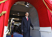 Washington, DC - January 20, 2009 -- United States President-elect Barack Obama smiles as he walks through an archway at the Capitol and onto the platform where he will be sworn-in as the 44th President of the United States and the first African-American to lead the nation at the Capitol in Washington Tuesday, January 20, 2009. .Credit: J. Scott Applewhite - Pool via CNP