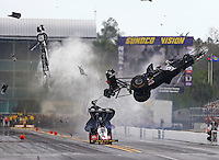 Mar 14, 2015; Gainesville, FL, USA; NHRA top fuel dragster driver Larry Dixon (right) crashes and goes airborne alongside Doug Kalitta after his car broke in half during qualifying for the Gatornationals at Auto Plus Raceway at Gainesville. Dixon walked away from the incident. Mandatory Credit: Mark J. Rebilas-USA TODAY Sports