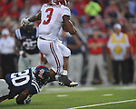Alabama running back Trent Richardson (3) is cased by Ole Miss' Aaron Garbutt (20) at Vaught-Hemingway Stadium in Oxford, Miss. on Saturday, October 14, 2011. Alabama won 52-7.