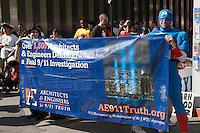 Supporters of Architects and Engineers for 9/11 Truth (AE911Truth) hold up a banner at the WTC PATH station.