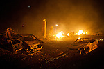 SAN BRUNO, CA - SEPTEMBER 9: Chimneys and burnt-out cars remain September 9, 2010 in a San Bruno, California residential street. A massive explosion rocked a neighborhood near San Francisco International Airport.
