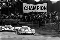 LE MANS, FRANCE - JUNE 16: The winning New-Man-Joest Racing Porsche 956B 117 driven by Klaus Ludwig, Paolo Barilla and John Winter leads the second-place Richard Lloyd Racing Porsche 956 GTi 106B driven by Jonathan Palmer, James Weaver and Richard Lloyd during the 24 Hours of Le Mans FIA World Sports Car Championship race at the Circuit de la Sarthe in Le Mans, France on June 16, 1985.