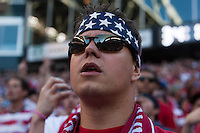 A USA fan reacts to a call while watching the USA Men's National Team's World Cup Qualifier against Panama at Century Link Field in Seattle, WA on June 11, 2013.