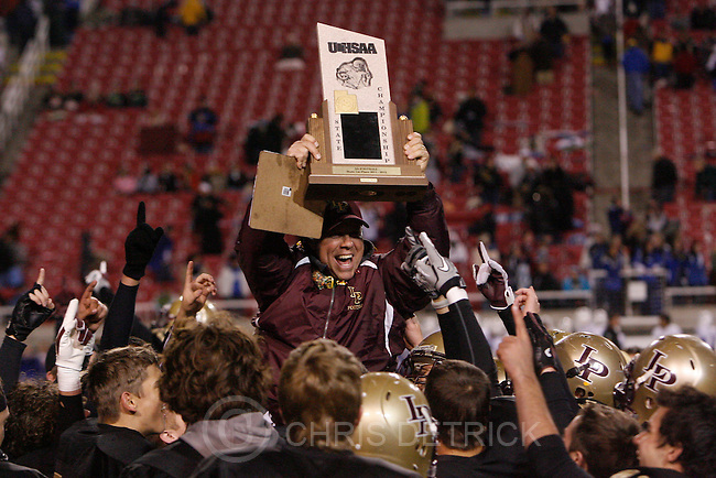 Chris Detrick  |  The Salt Lake Tribune.Lone Peak head coach Tony McGear celebrates with his team after the 5A Championship game at Rice-Eccles Stadium  Friday November 18, 2011.  Lone Peak defeated Fremont 41-21.