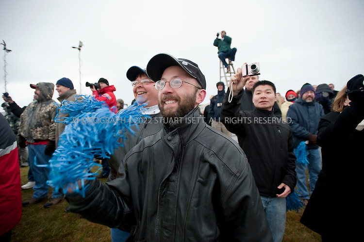 12/15/2009--Everett, WA, USA..Crowds cheered and waved blue pom-poms as the Boeing 787 Dreamliner took off a little after 10 am Pacific Coast time on its maiden flight from Paine Field, WASH...The Boeing 787 Dreamliner is a mid-sized, wide body, twin engined jet airliner currently under development by Boeing .It will carry between 210 and 330 passengers depending on the seating configuration. Boeing has stated that it will be more fuel-efficient than comparable earlier Boeing airliners. It will also be the first major airliner to use composite material for most of its construction. Boeing claims that the 787 will be up to 20% more fuel-efficient than current comparable aircraft. ..50% of the aircraft's weight are from the composite materials shown here. Composite materials are significantly lighter and stronger than traditional aircraft materials, making the 787 a very light aircraft for its capabilities. By volume, the 787 will be 80% composite. This will allow the potential to take off from, and land on, relatively short airstrips as the 767 can, yet still have the capability to fly long-haul distances....©2009 Stuart Isett. All rights reserved