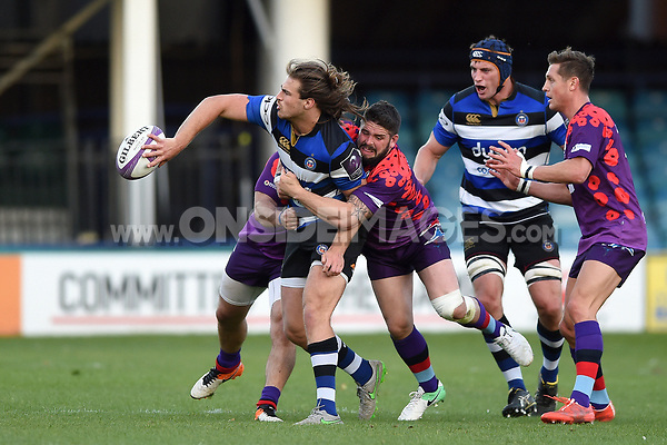 Max Clark of Bath United looks to offload the ball after being tackled by Lpt Ben Priddey of the UK Armed Forces. Remembrance Rugby match, between Bath United and the UK Armed Forces on May 10, 2017 at the Recreation Ground in Bath, England. Photo by: Patrick Khachfe / Onside Images